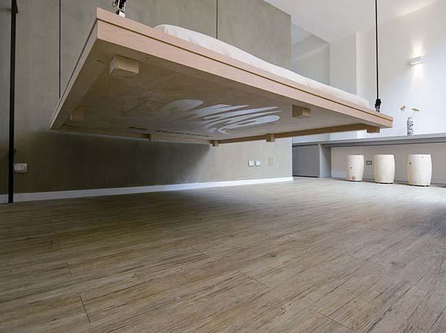 bien phong khach thanh phong ngu 02 Mẫu thiết kế độc đáo biến phòng khách thành phòng ngủ với chiếc giường treo